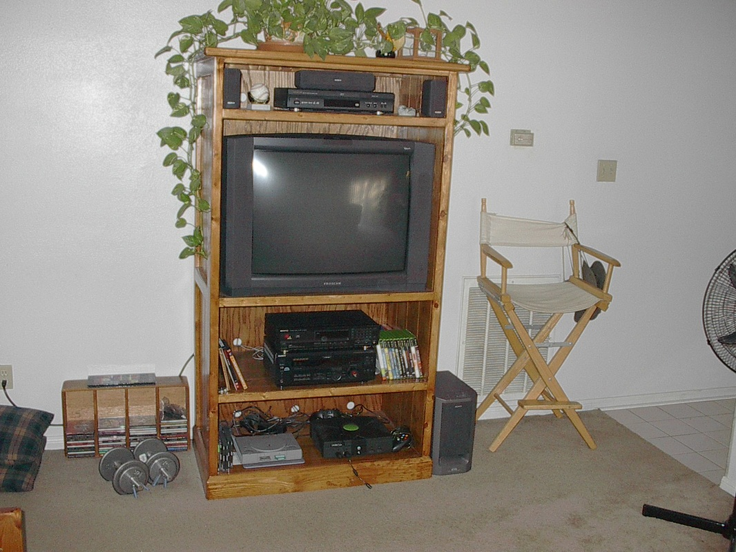 Custom Television Cabinet Made from Shipping Pallets and Old Playsets